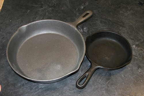 My new 'unseasoned' pan and my small pan that needed to be re seasoned.