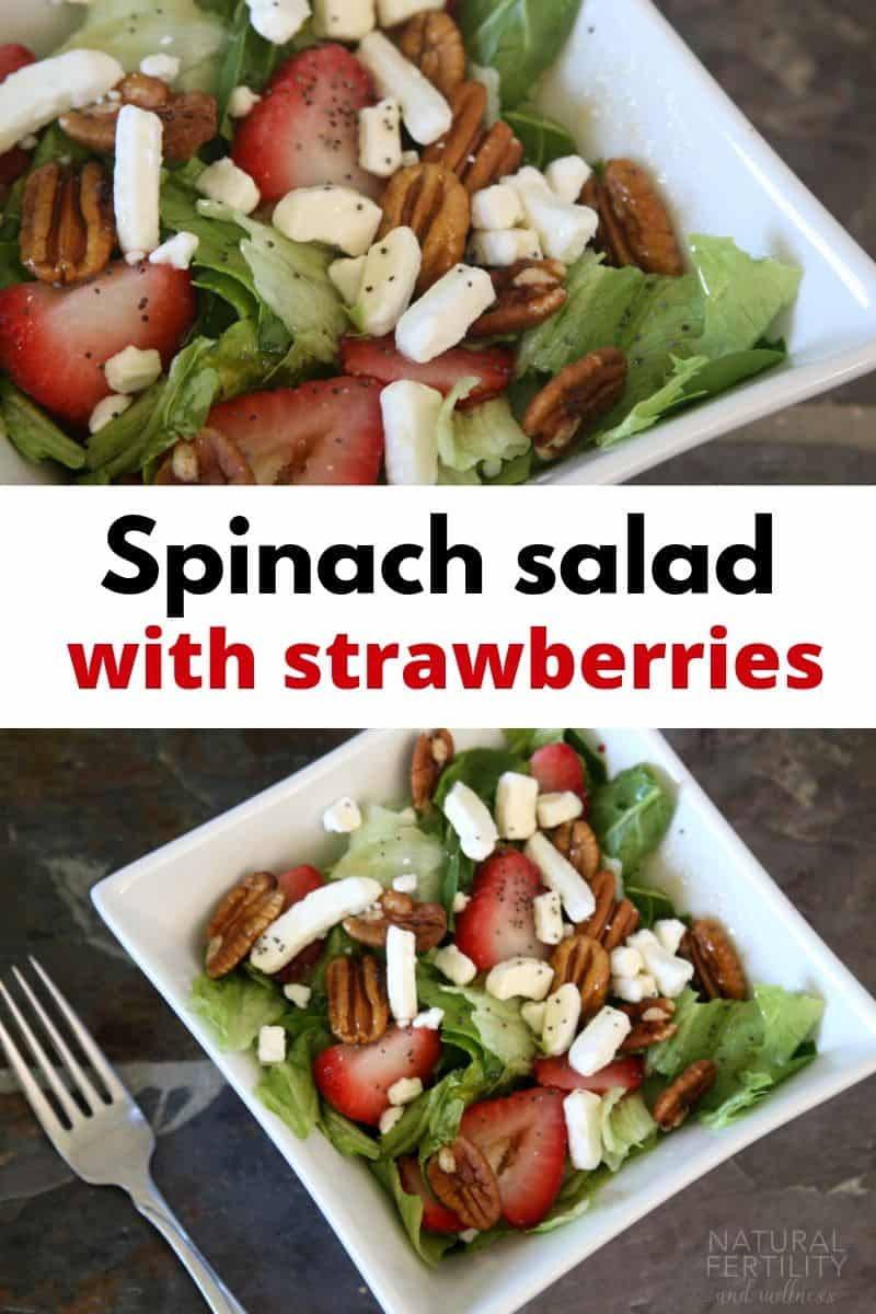Spinach salad with strawberries in bowl