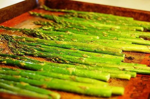 roasted asparagus on pan