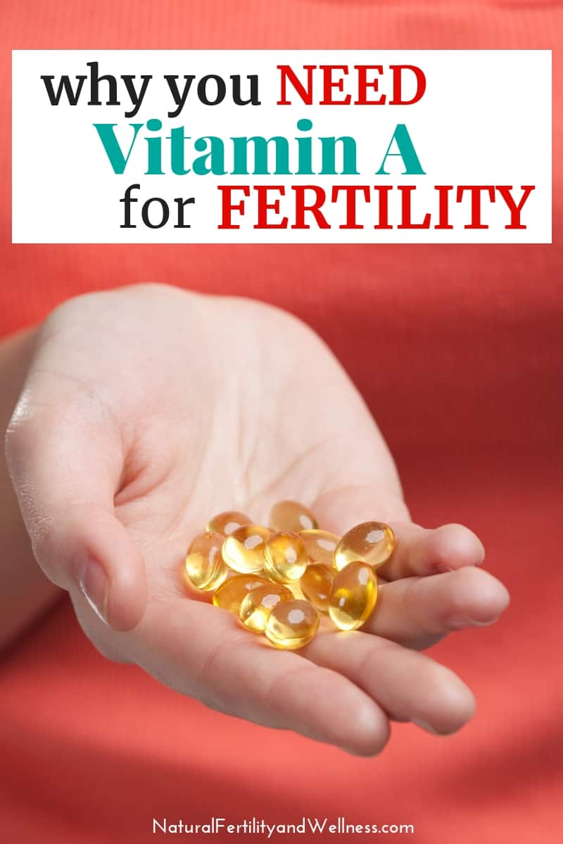 hand holding vitamin a supplements
